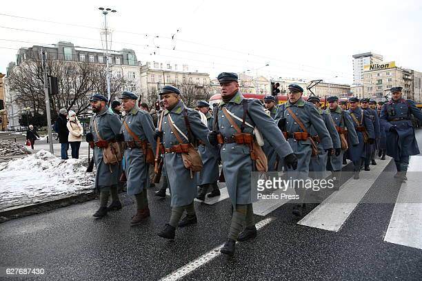 Polish Army celebrated 100th anniversary of march in Warsaw during Russian occupation A convoy of soldiers moved on horses carrying waggons and...