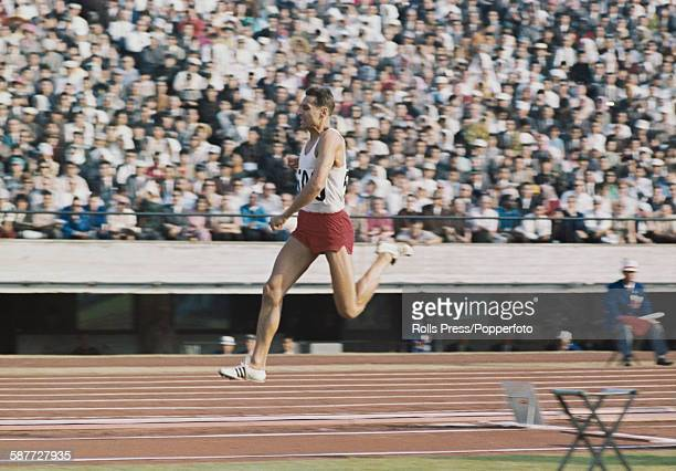 Polish athlete Jozef Szmidt pictured in action during the men's triple jump competition at the 1964 Summer Olympics in Tokyo Japan on 16th October...