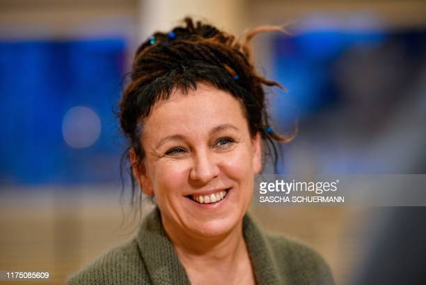 TOPSHOT Polish author Olga Tokarczuk addresses a press conference on October 10 2019 in Bielefeld western Germany after she was awarded with the 2018...