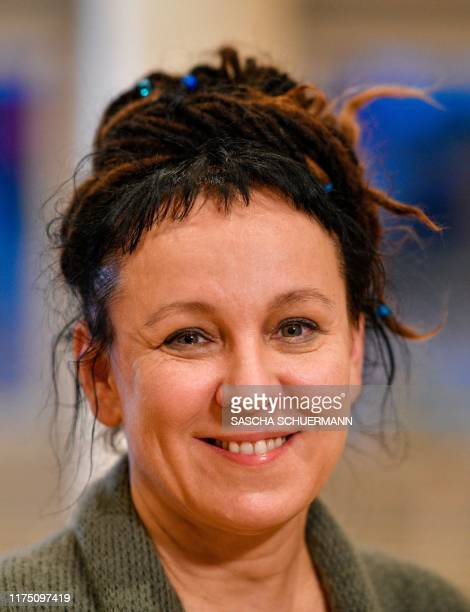 Polish author Olga Tokarczuk addresses a press conference on October 10 2019 in Bielefeld western Germany after she was awarded with the 2018 Nobel...