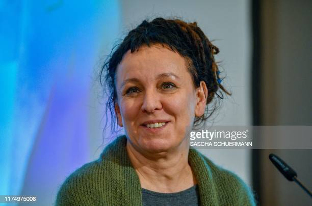 Polish author Olga Tokarczuk poses on October 10 2019 in Bielefeld western Germany before addressing a press conference after she was awarded with...