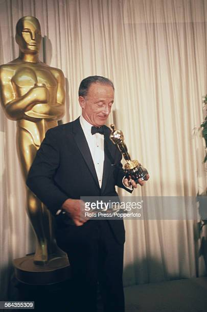 Polish born American film director Fred Zinnemann pictured holding two Academy Awards, or Oscars, awarded for Best Picture and Best Director for the...