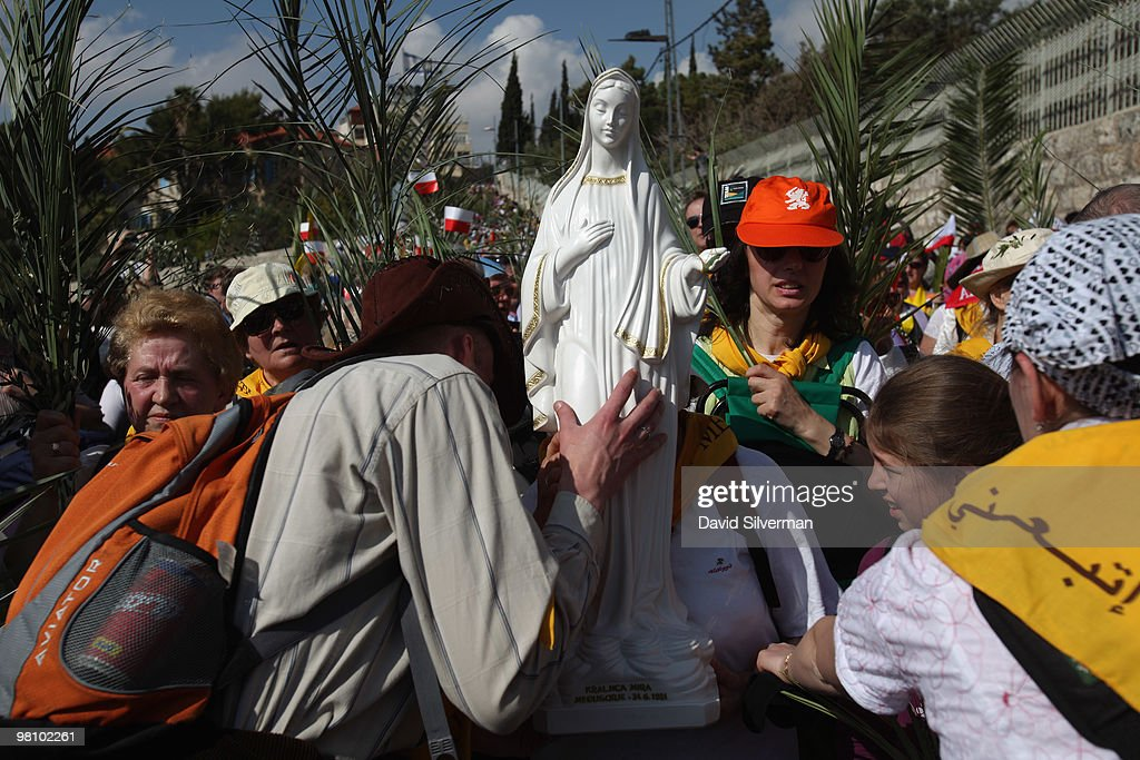 Polish Catholic pilgrims carry their church's statue of Madonna as they walk down the Mount of Olives to the Old City during the traditional Palm Sunday procession on March 28, 2010 in Jerusalem, Israel. Palm Sunday, which marks the start of Holy Week, is a landmark in the Christian calendar, marking the triumphant return of Jesus to Jerusalem the week before his death when a cheering crowd greeted him waving palm leaves.
