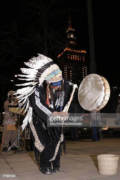 Polish citizens watch Ecuadorians dancing and playing drums in central Warsaw 10 December 2003 A group of musicians from Ecuador dressed as Native...