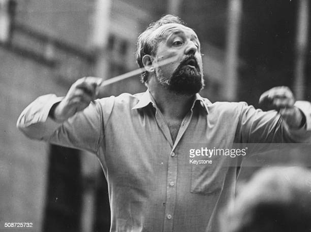 Polish composer Krzysztof Penderecki pictured conducting an orchestra 1980
