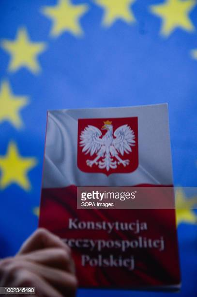 A polish constitution and a European Union flag are seen during the protest People demonstrate against reforms of the Supreme Court and demand for...