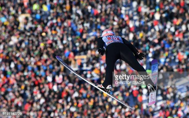 Polish Dawid Kubacki soars in the air during a training jump at the Four-Hills Ski Jumping tournament, on December 28, 2019 in Oberstdorf, Germany. -...