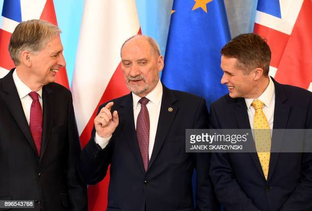 Polish Defence Minister Antoni Maciarewicz talks with Britain's Chancellor of the Exchequer Philip Hammond and Britain's Defence Secretary Gavin...