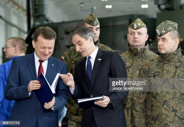 Polish Defence Minister Mariusz Blaszczak speaks with the US Ambassador to Poland Paul W Jones after signing a contract to buy a US-made Patriot...