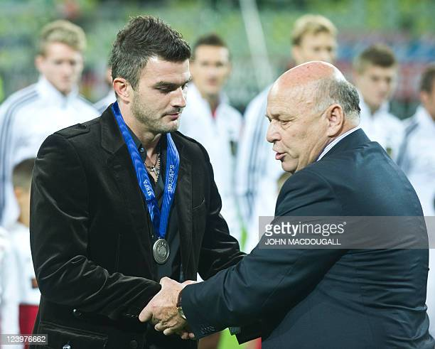 Polish defender Michal Zewlakow is awarded a medal for European national team players who have reached 100 caps prior to the International friendly...