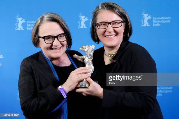 Polish director Agnieszka Holland and her daughter and codirector Kasia Adamik pose the Silver Bear Alfred Bauer Prize for the movie 'Pokot'...