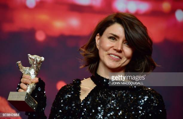 Polish director and screenwriter Malgorzata Szumowska poses with her Silver Bear Grand Jury Prize trophy she was awarded for the movie 'Mug' during a...