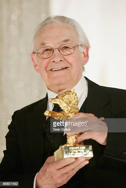Polish director Andrzej Wajda poses with The Honorary Golden Bear during the 56th Berlin International Film Festival on February 15 2006 in Berlin...