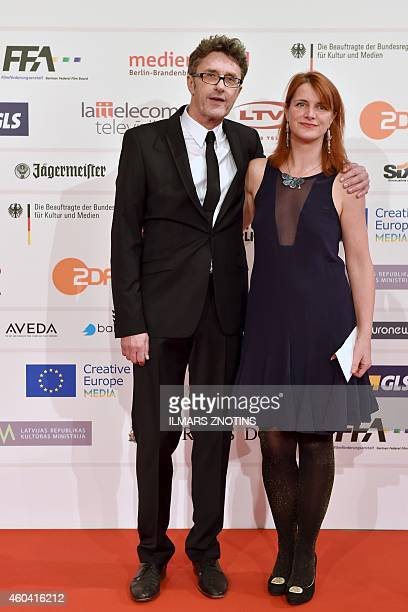 Polish director Pawel Pawlikowski and British writer Rebecca Lenkiewicz pose for photographers on the red carpet upon arrival for the 27th European...