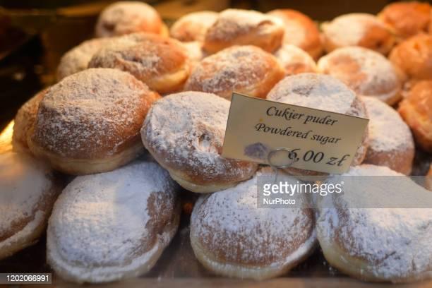 Polish doughnuts seen for sale on Fat Thursday in Krakow Every February Poland and Poles 'go nuts' for doughnuts on Fat Thursday the last Thursday...