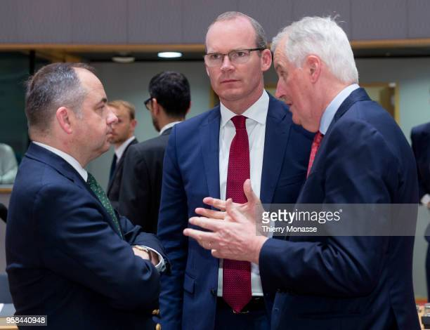 Polish European affairs minister Konrad Szymanski Irish Minister for Foreign Affairs Trade Simon Coveney and the European Chief Negotiator for the...