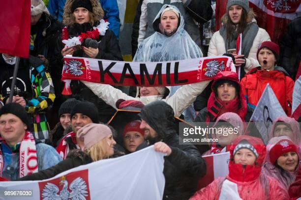 Polish fans celebrate the victory of ski jumperKamil Stoch in the Four Hills Tournament in Innsbruck Austria 4 January 2018 Photo Daniel Karmann/dpa