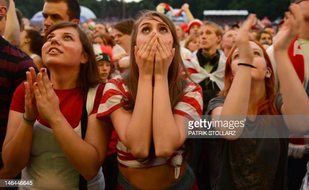 Polish fans react as they watch the Group A football match Poland Czech Republic on a giant screen at the fanzone in Gdansk on June 16 2012 during...
