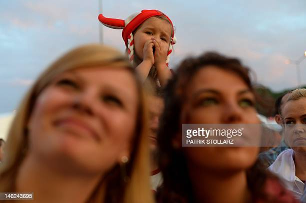 Polish fans watch the Euro 2012 football championships match Russia vs Poland on June 12 2012 at the fanzone in Gdansk AFP PHOTO / PATRIK STOLLARZ