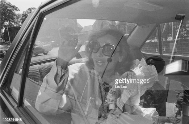 polish fashion model and actress Malgosia Tomassi waves at paparazzi as she arrives in a car at Reading Jail to visit her partner American actor...