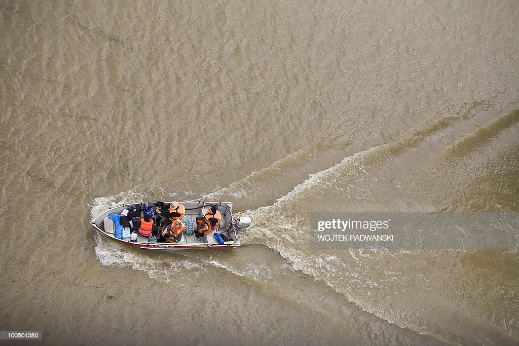 Polish firemen deliver food by boat to people in the flooded area of Swiniary village, in central Poland, near the Wisla river on May 25, 2010. Floods caused by torrential rains last week have swollen major Polish rivers to their highest levels in more than a century and have claimed 15 lives.