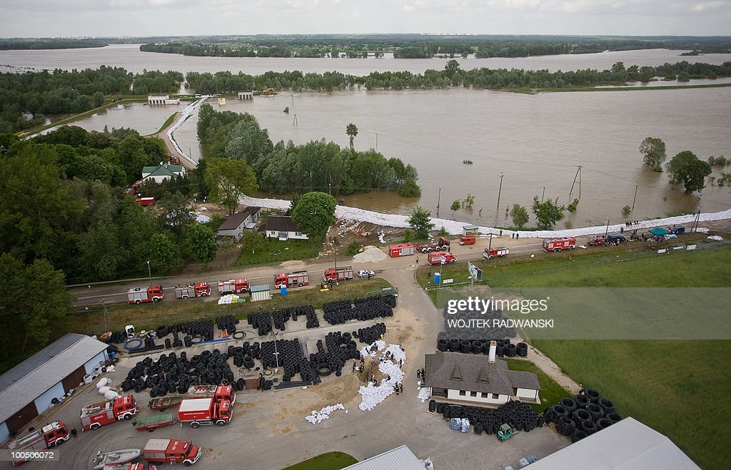 Polish firemen fight the flood in Dobrzykow village in central Poland at Wisla river on May 25, 2010. Torrential rain in Poland's mountainous south have caused rivers, including the Vistula, Poland's largest, swell to levels unseen in more than a century.