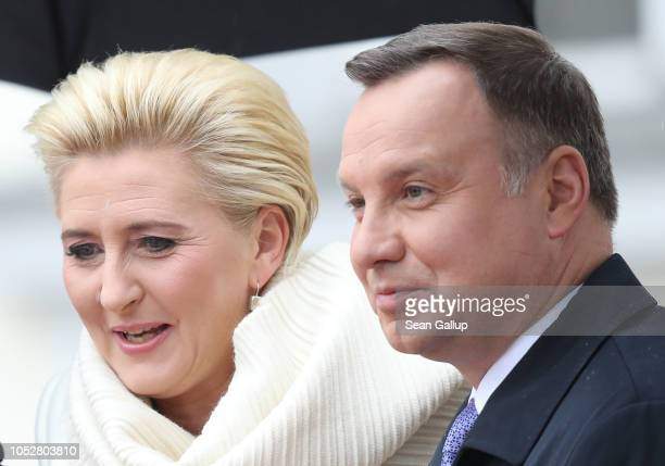 Polish First Lady Agata Kornhauser-Duda and Polish President Andrzej Duda pose for photographers under a light rain outside Schloss Bellevue...