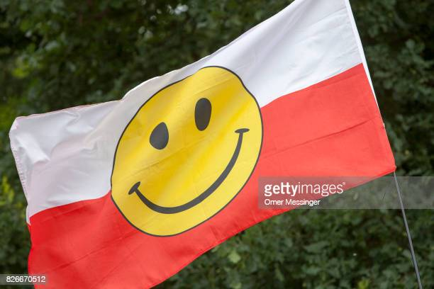 A polish flag with a smiley face printed on it is seen waving in the wind in one of the camps at the 2017 Woodstock Festival Poland on August 4 2017...