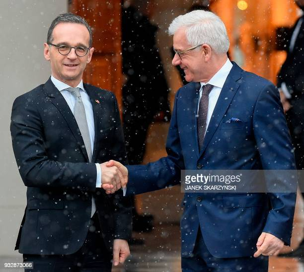 Polish Foreign Minister Jacek Czaputowicz and his German counterpart Heiko Maas shake hands prior their meeting on March 16 2018 in Warsaw The new...