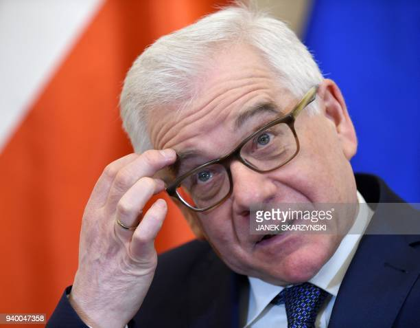 Polish Foreign Minister Jacek Czaputowicz gestures during an interview with AFP in Warsaw on March 29 2018 Poland may be under the threat of...
