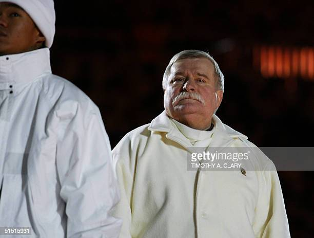 Polish former President Lech Walesa attends 08 February 2002 the opening ceremonies of the 2002 Winter Olympics at the Rice Eccles Stadium in Salt...