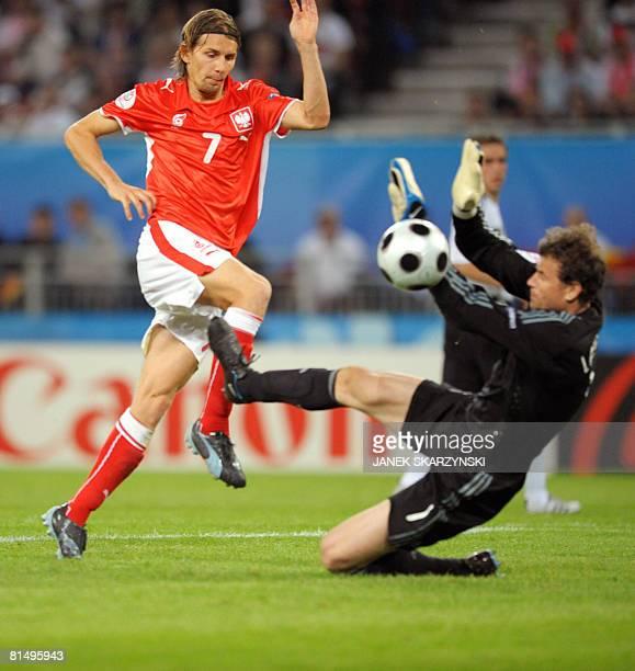 Polish forward Euzebiusz Smolarek vies with German goalkeeper Jens Lehmann during their Euro 2008 Championships Group B football match Germany vs....