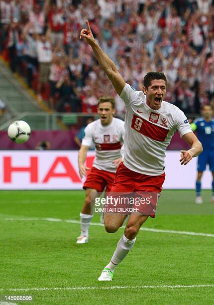 Polish forward Robert Lewandowski reacts after scoring a goal during the Euro 2012 championships football match Poland vs Greece on June 8 2012 at...