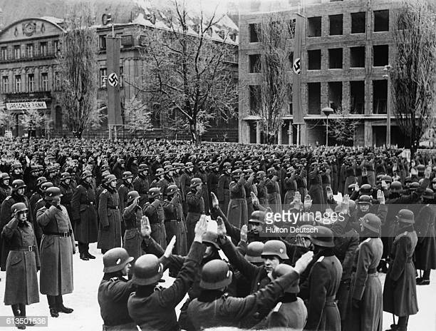 Polish Germans recruited for the Wehrmacht are sworn into the army in a mass ceremony The men give the Nazi salute as they repeat their oaths