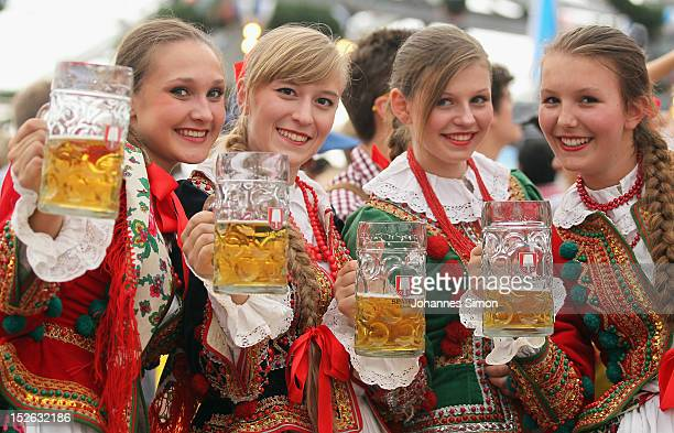 Polish girls dressed with traditional Polish costume enjoy drinking beer after participating in the opening parade during day 2 of Oktoberfest beer...