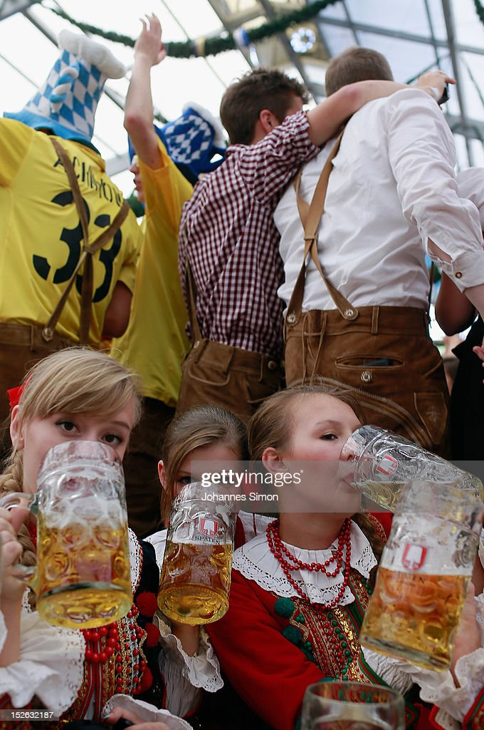 Polish girls, dressed with traditional Polish costume enjoy drinking beer after participating in the opening parade during day 2 of Oktoberfest beer festival on September 22, 2012 in Munich, Germany.This year's edition of the world's biggest beer festival Oktoberfest will run until October 7, 2012.