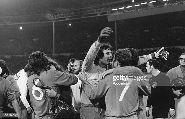 Polish goalkeeper Jan Tomaszewski is congratulated by his teammates for his performance in a World Cup qualifying match against England at Wembley,...