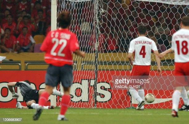 Polish goalkeeper Jerzy Dudek is beaten for a goal off a shot by South Korea's Hwang Sun Hong in the 26th minute, 04 June 2002 at the Busan Asiad...