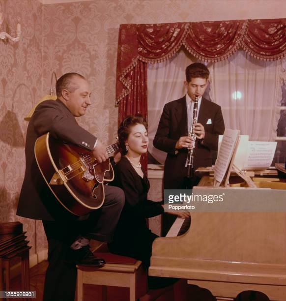 Polish guitarist and teacher Ivor Mairants plays guitar with his son on clarinet and daughter on piano at home in London in June 1957