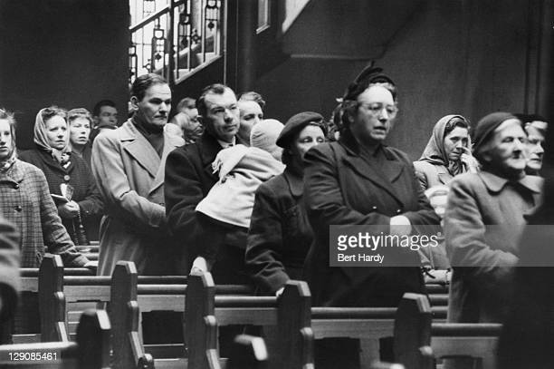 Polish immigrants attend a service at the Polish Church of St Bride's Cheapside Street Glasgow Scotland March 1955 Original publication Picture Post...