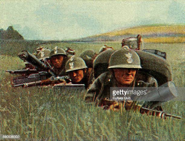 Polish infantry with heavy machine guns in the battlefield Capacity is 800 shots per minute Cigarette cards published in Germany c1934 reviewing...