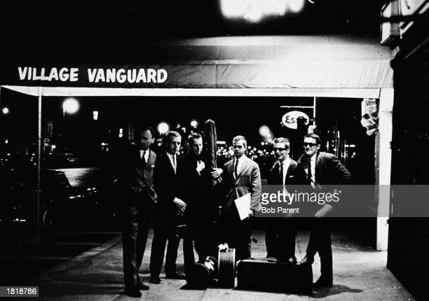 A Polish jazz band poses under the awning of the jazz club the Village Vanguard at night New York City June 10 1962