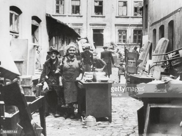 Polish Jews from Bedzin on the street with their belongings before their relocation to the ghetto Around 1940 Photography [Polnische Juden aus Bedzin...