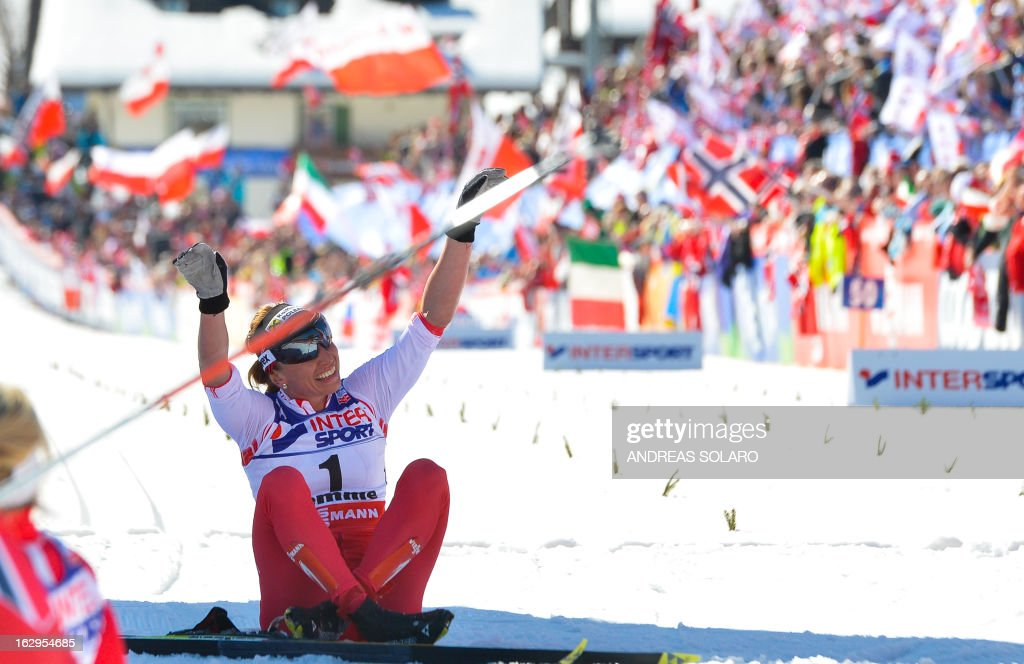 Polish Justyna Kowalczyk celebrates on March 2, 2013 in the finish area of the Women's Cross Country 30 km Classic race of the FIS Nordic World Ski Championships at Val Di Fiemme Cross Country stadium in Cavalese, northern Italy.