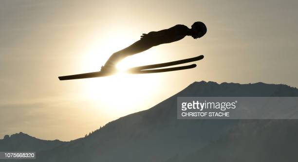 Polish Kamil Stoch soars through the air during his training jump at the first stage of the Four-Hills Ski Jumping tournament , in Oberstdorf,...