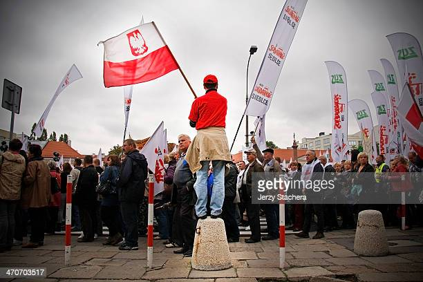 Polish labor-union member protest march through Warsaw against the government's labor and wage policies.