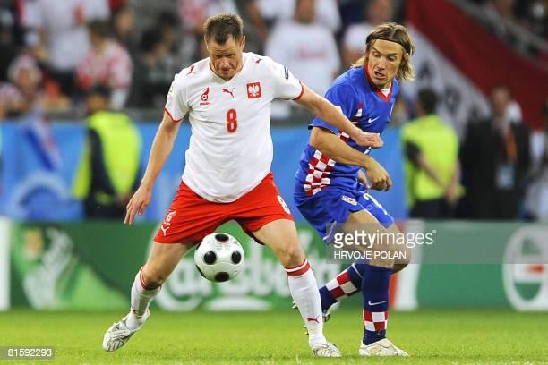 Polish midfielder Jacek Krzynowek vies with Croatian defender Dario Simic during the Euro 2008 Championships Group B football match Poland vs....