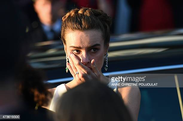 Polish model and actress Kasia Smutniak cries as she leaves the Festival palace after the screening of the film 'Mia Madre' at the 68th Cannes Film...