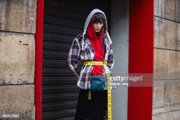 Polish model Karo Laczkowska wears a Superdry purple plaid shirt with a hood a red hoodie a 'Hold Me Tight' PLNY LALA belt turquoise Kenneth Cole...