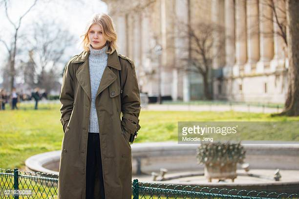 Polish model Ola Rudnicka wears a green trench coat and gray turtleneck after the Chanel show at Grand Palais on Day 8 of PFW FW16 on March 08 2016...